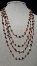 onxy-garnet-sunstone-long-neck